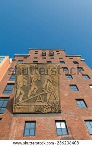 DUSSELDORF - SEPTEMBER 6, 2014: Restored factory building in the media harbor. The Hafen district contains some spectacular post-modern architecture, but also some bars, restaurants and pubs - stock photo