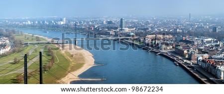 Dusseldorf, View on Rhine river, Oberkasseler bridge, Old Town and modern districts from Rheinturm TV tower, Germany - stock photo