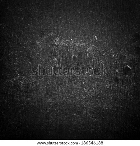 Dust and Scratches on Black Surface - stock photo