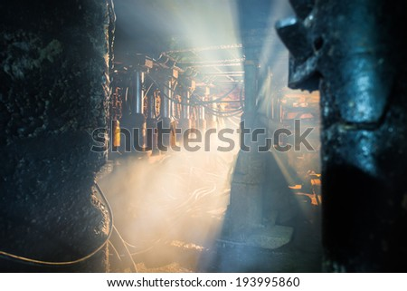 dust and smoke in coal mine, hydraulic machinery - stock photo
