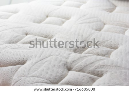 Best Way To Dust Furniture Concept dust mites on bed mattress background stock photo 716685808