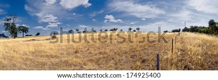 dusty dry farmland in australia during summer - stock photo
