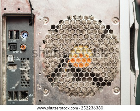 Dusty old computer, rear panel connectors and and clog the cooling fan - stock photo