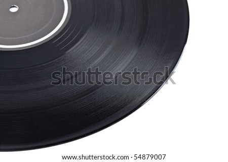 Dusty vinyl record with black label isolated on white background. Shallow depth of field