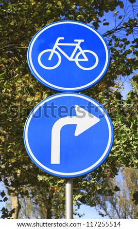 Dutch blue road sign with arrow turn right for bicycles