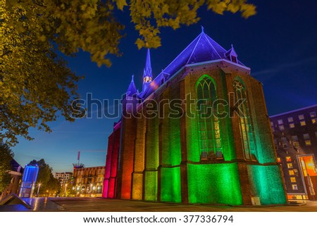 Dutch castle with colourful light up at night - stock photo
