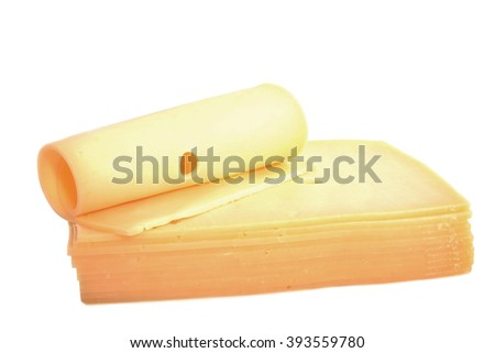 Dutch cheese slices with holes isolated over white - stock photo
