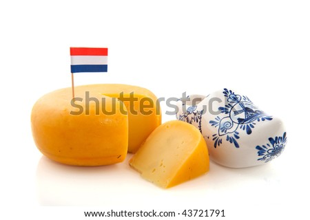 Dutch cheese with flag and clogs isolated over white - stock photo