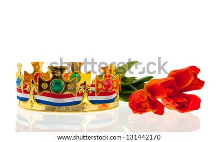 Dutch golden crown with flag colors and tulips for the king isolated over white background - stock photo