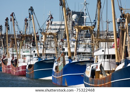 Dutch harbor of IJmuiden with modern fishing cutters - stock photo