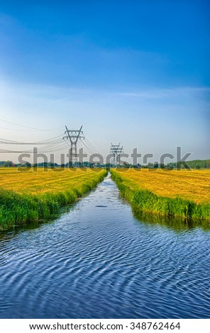Dutch landscape with a canal and grass fields with mirror reflection in water, Amsterdam, Holland, Netherlands, HDR - stock photo