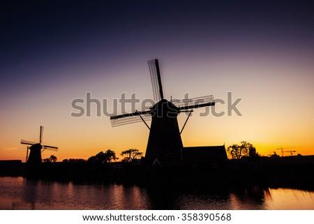 Dutch mill by night. Holland. Netherlands.  - stock photo