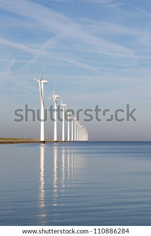 Dutch offshore wind turbines in a calm sea - stock photo