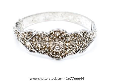 Dutch ornamented (zeeuwse knoop) silver slave bangle bracelet against a white background - stock photo