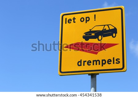 Dutch road sign: speed bumps (translation: pay attention, speed bumps)