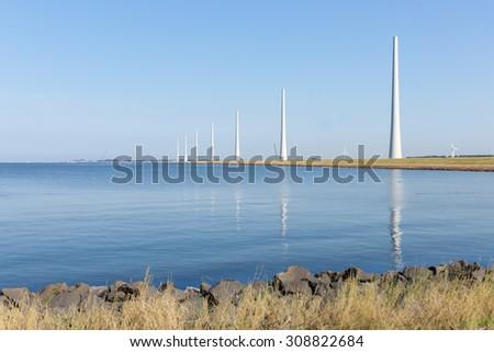 Dutch sea with new big windturbines under construction - stock photo