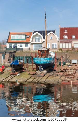 Dutch shipyard of Urk with historic fishing ships - stock photo
