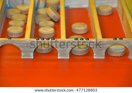 Dutch shuffle board game with wooden pucks
