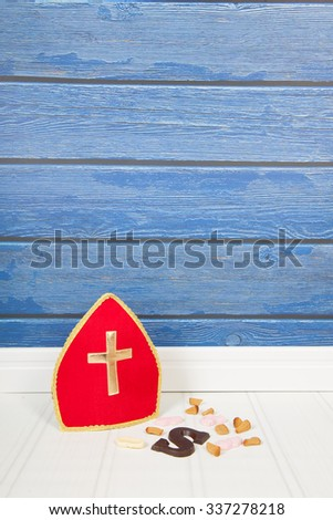 Dutch Sinterklaas candy and mitre on blue background - stock photo