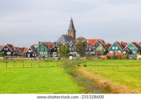 Dutch typical rural pastoral landscape with authentic buildings, water canals and green meadow (Marken. Netherlands)  - stock photo