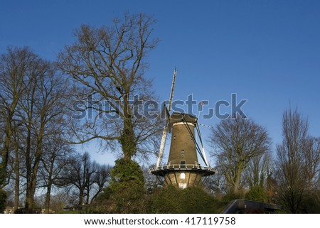 Dutch windmill and trees - stock photo