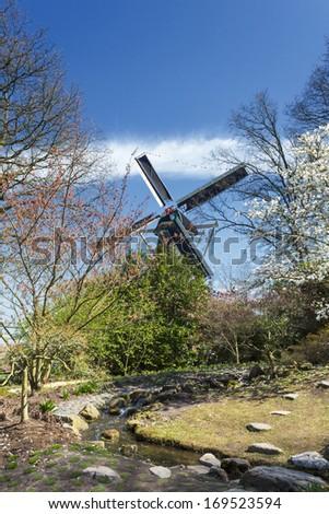 Dutch windmill in Keukenhof, Netherlands - stock photo