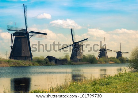 "Dutch windmills in ""Kinderdijk"", a famous village in the Netherlands where you can visit the old traditional windmills - stock photo"