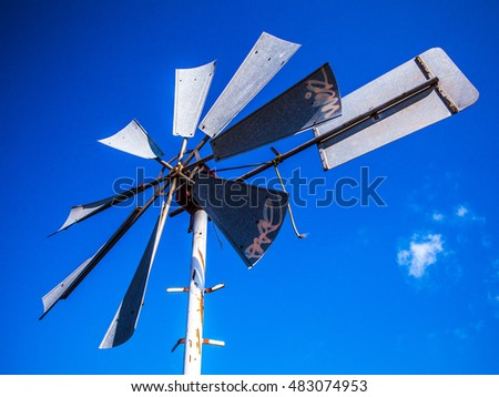 Dutch windmills with blue sky.