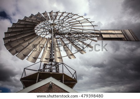 Dutch windmills with dramatic cloudy sky close-up.