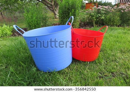 Duty plastic blue red garden pots stock photo 100 legal protection duty plastic blue and red garden pots with handles on the lawn in the summer garden workwithnaturefo