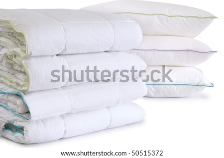 Duvets and pillows. Isolated - stock photo