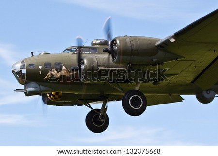 "DUXFORD, CAMBRIDGESHIRE, UK - JUNE 30: Boeing B-17G Flying Fortress ""Sally B"" flying on June 30, 2012 at the Duxford Legends Air Show at Duxford, Cambridgeshire, UK. - stock photo"