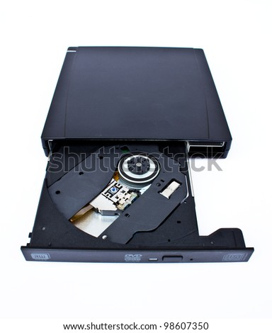 DVD-ROM in drive on white - stock photo