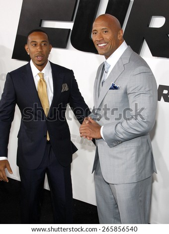 Dwayne 'The Rock' Johnson and Chris 'Ludacris' Bridges at the Los Angeles premiere of 'Furious 7' held at the TCL Chinese Theatre IMAX in Hollywood, USA on April 1, 2015. - stock photo