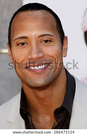"Dwayne 'The Rock' Johnson attends the World Premiere of ""The Game Plan"" held at the El Capitan Theater in Hollywood, California, United States on September 23, 2007.  - stock photo"