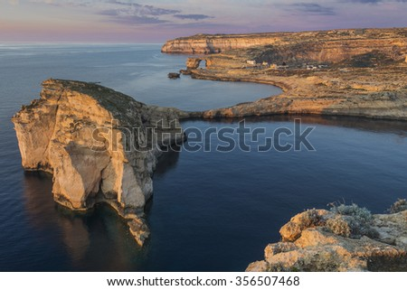 Dwejra Bay, Fungus Rock, Azure Window and Inland Sea in one photo displaying the most popular tourist attraction on the Island of Gozo, part of the Maltese archipelago.