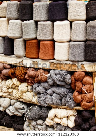 Dyed and undyed natural sheep wool - stock photo