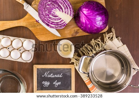 Dyeing Easter eggs with natural dye colors. - stock photo