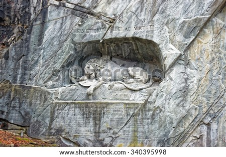 Dying Lion monument, a sculpture in Lucerne (Switzerland) carved in the rock to honor Swiss Guards who were massacred during the French Revolution when revolutionaries stormed the Tuileries Palace  - stock photo