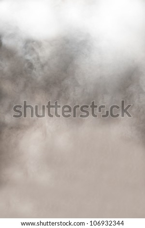 Dynamic background of thick clouds of grey and white swirling smoke from a burning fire or fog with an ethereal spiritual quality - stock photo