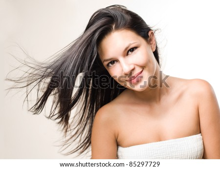 Dynamic beauty shot of gorgeous brunette with flowing hair.