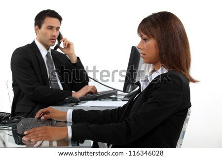 Dynamic business duo - stock photo