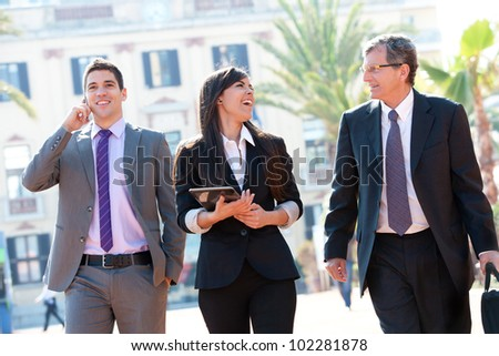 Dynamic Business team laughing at outdoor meeting.