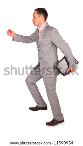dynamic businessman with notebook - stock photo