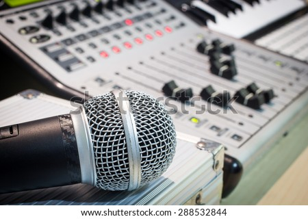 dynamic microphone, digital studio mixer & keyboard synthesizer, focus to mic for music recording, radio / tv broadcasting  background - stock photo