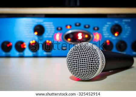 dynamic microphone & recording studio gears on background for studio music recording concept - stock photo