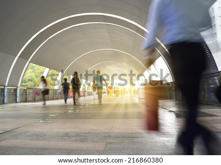 Dynamic photo of busy crowd of people walking, blurred motion. - stock photo