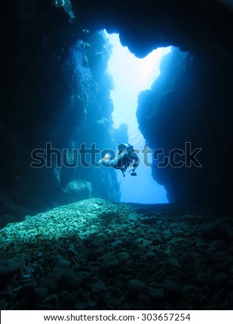 Dynamic undersea-scape with exploring diver in Okinawa-Aguni island