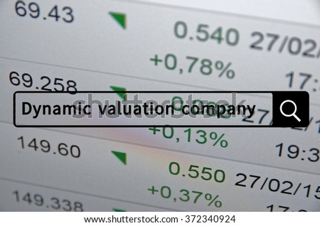 Dynamic valuation company written in search bar with the financial data visible in the background. - stock photo