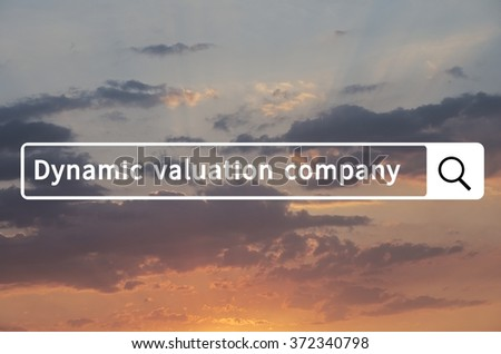 Dynamic valuation company written in search bar with the sunset visible in the background. - stock photo